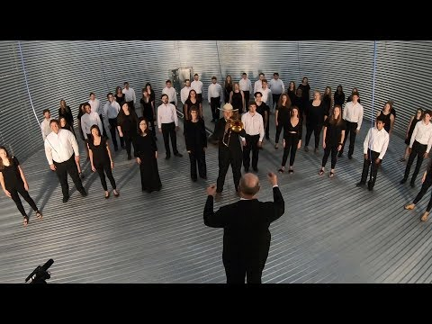 A choir singing Down To The River To Pray) in an empty grain bin. Beautiful acoustics.