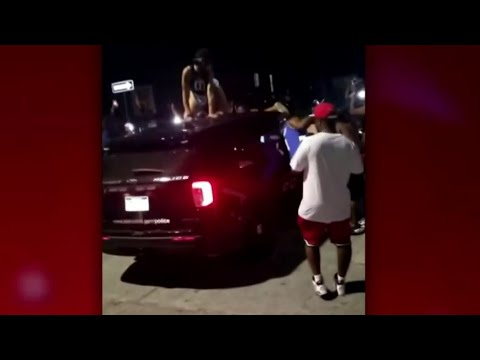 DPD head applauds officer for restraint after woman dances on top of police cruiser