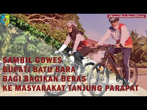 Sambil Gowes, Bupati Batu Bara Bagikan Beras ke Masyarakat Desa Tanjung Parapat