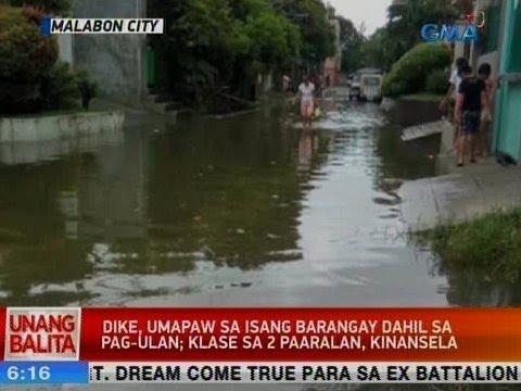 [GMA]  UB: Dike, umapaw sa isang barangay sa Malabon dahil sa pag-ulan; klase sa 2 paaralan, kinansela