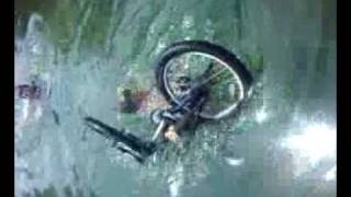 Joe and daryl geting joes bike out of the water