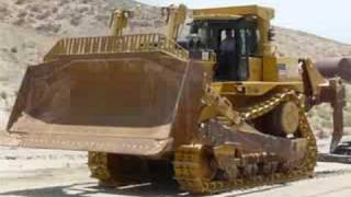 Unloading a CAT D10T from MARCO trucking 9 axle Murray