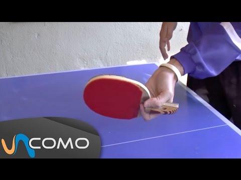 Coger la pala de ping pong