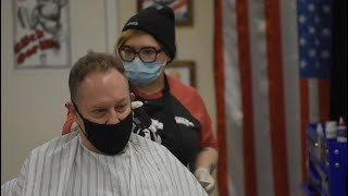 In defiance of Governor Ned Lamont's executive order Kat Thibodeau opened her barbershop, Modern Barber, in Pawcatuck on Wednesday morning.