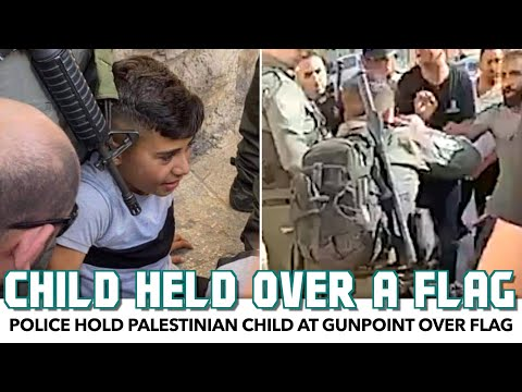 Police Hold Palestinian Child At Gunpoint Over Flag
