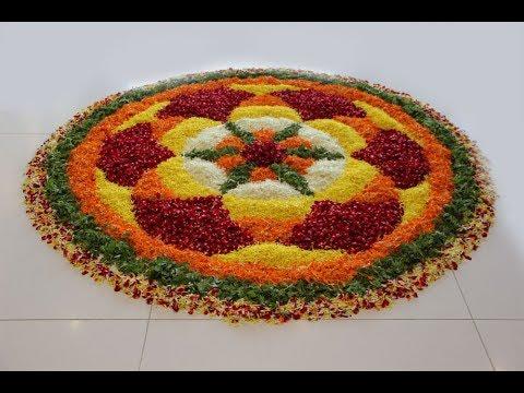 big onam flower rangoli design with fragrant flowers