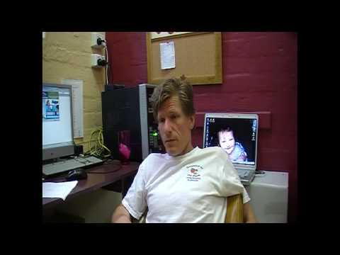 Image of David Kupisiewicz sitting at a desk