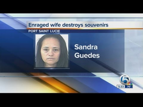 Video Enraged wife destroyes souvenirs