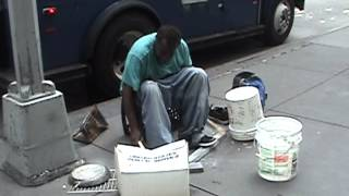 Homeless in the street playing drums with garbage (Original)