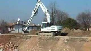 Liebherr R924B Working On A River Bank Consolidation Project - Italy 2008
