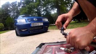 HOW TO GAP AND CLEAN YOUR SPARK PLUGS VERY EASY VW JETTA 1 8T AUDI AND ANY OTHER CAR