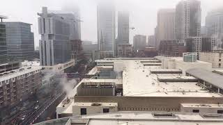 It's SNOWING in Charlotte, North Carolina. Watch as bad weather hits Uptown.