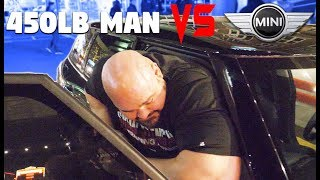 """TRYING TO FIT INTO A MINI COOPER *6'8"""" 450LBS* 