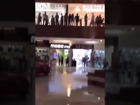 Mall starts to flood and band begins to play the Titanic song.