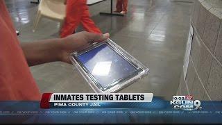 Inmates testing tablets at the Pima County Jail