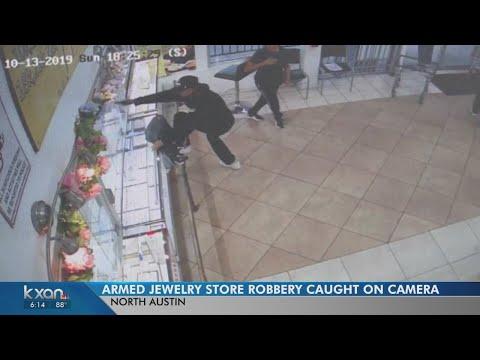 Surveillance captures 2 men rob jewelry store at gunpoint in north Austin