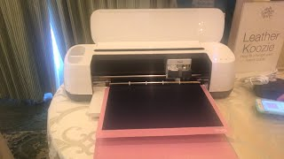 The New Cricut Maker Machine in action  using the new fabric mat cutting Faux Leather