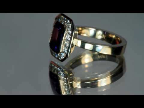 Exceptional Emerald Cut Tanzanite in a Christopher Michael Designed Ring