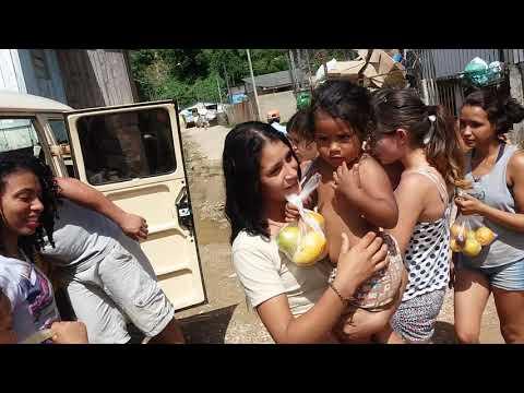 A judando a conidade de almirante Tamandaré as crianças carente(1)
