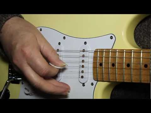 How to tune a guitar.  Beginners lesson to tune your guitar.