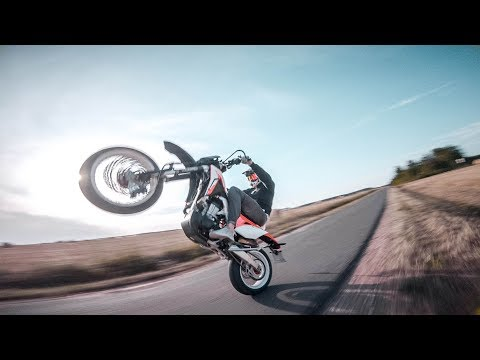 fpv-racing-drone-chasing-motorcycle-supermoto--se-fpv