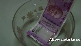 removing ink marks from currency bill