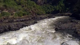 Victoria falls flight down gorge in helicopter. HD.