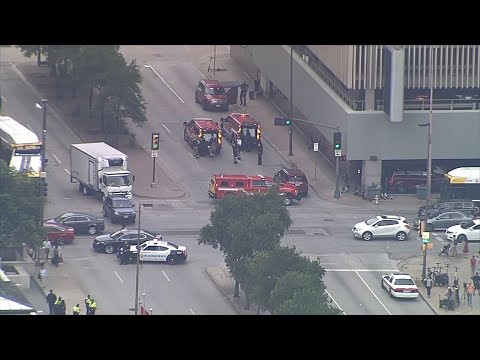 A masked gunman opened fire Monday on a federal courthouse in downtown Dallas before being fatally shot in an exchange of gunfire with federal officers, witnesses and authorities said. (June 17)