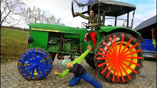 Tractor with colored Wheels! Liam to the rescue on power wheels