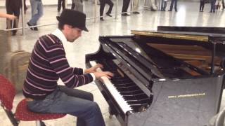 Amazing pianist at Heathrow airport arrivals hall