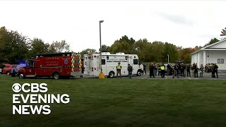 """A suspected gunman was arrested Saturday night after opening fire inside a church in New Hampshire. It happened during a wedding ceremony in Pelham. Police say the man arrived and began shooting after the ceremony started. At least two people were shot. Guests tackled the suspect and held him until police arrived.  Subscribe to the """"CBS Evening News"""" Channel HERE: http://bit.ly/1S7Dhik Watch Full Episodes of the """"CBS Evening News"""" HERE: http://cbsn.ws/23XekKA Watch the latest installment of """"On the Road,"""" only on the """"CBS Evening News,"""" HERE: http://cbsn.ws/23XwqMH Follow """"CBS Evening News"""" on Instagram: http://bit.ly/1T8icTO Like """"CBS Evening News"""" on Facebook HERE: http://on.fb.me/1KxYobb Follow the """"CBS Evening News"""" on Twitter HERE: http://bit.ly/1O3dTTe Follow the """"CBS Evening News"""" on Google+ HERE: http://bit.ly/1Qs0aam  Get your news on the go! Download CBS News mobile apps HERE: http://cbsn.ws/1Xb1WC8  Get new episodes of shows you love across devices the next day, stream local news live, and watch full seasons of CBS fan favorites anytime, anywhere with CBS All Access. Try it free! http://bit.ly/1OQA29B  --- The """"CBS Evening News"""" premiered as a half-hour broadcast on Sept. 2, 1963. Check local listings for CBS Evening News broadcast times."""