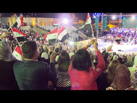 Amid raging war, Syria defiantly celebrates its independence day