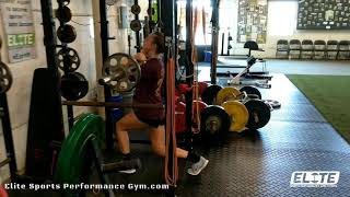 Elite Fastpitch Athlete performing a set of Barbell Front Split Squats