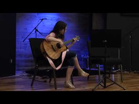 One of my students playing a fingerstyle arrangement of the theme from Beauty and the Beast.