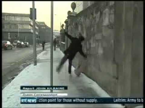 Man Slipping On Ice In Dublin - RTE News - EPIC FAIL!.flv
