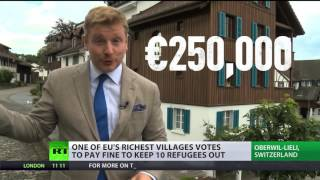 Refugee buy-out: Swiss village votes to pay fine to keep refugees out