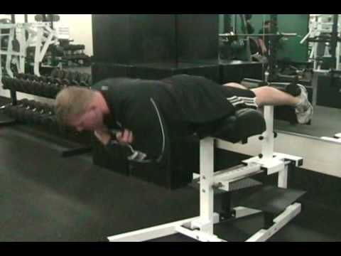 Weighted Static Back Extension Exercise Com