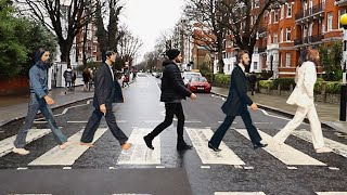 CROSSING ABBEY ROAD JUST LIKE THE BEATLES