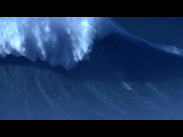 Surfer breaks world record by riding 80-foot wave