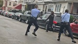video: Driver runs over policeman during protests after fatal shooting of black man in Philadelphia
