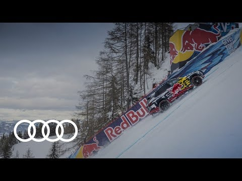 Driving an Electric Audi Up a Snow Covered Ski Slope