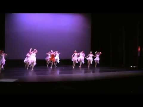 This is a piece that I choreographed for my Beautiful Aunt who passed away.  I am in the red dress and my students are in white.