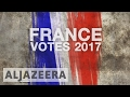 France election: Voters cast ballots in first round