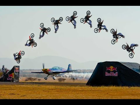 Insane Biker Backflips Over Flying Aeroplane In Incredibly Risky Stunt