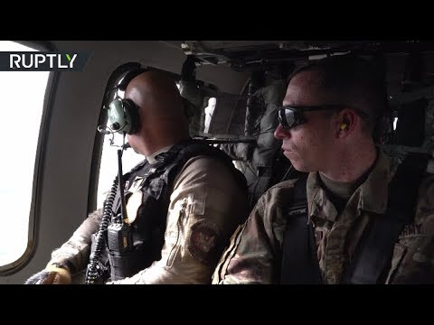 RAW: Black Hawk helicopter patrols US-Mexico border