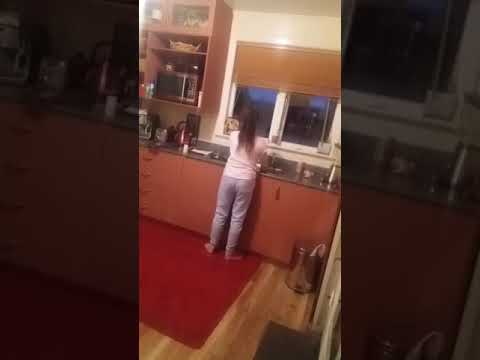 13 year old singing while washing the dishes