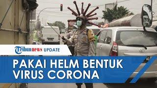 Wakapolres Mojokerta Gunakan Helm Virus Korona saat Semprot Disinfektan