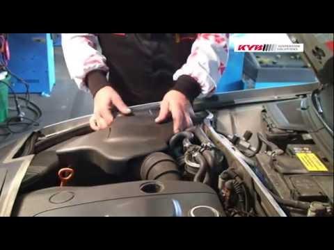 Замена передних амортизаторов KYB на Audi A4 8D