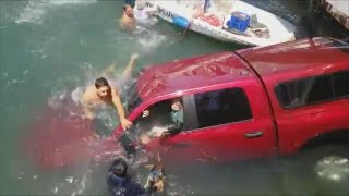 Strangers Rescue 87-Year-Old Woman, Her Son and Dog From Sinking Car