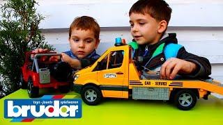 Распаковка игрушек Эвакуатор Mercedes-Benz Sprinter и джип Брудер 02535 Машинки Спецтехника #Bruder